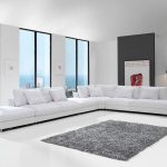 Sofá tapizado Yulian pata alta